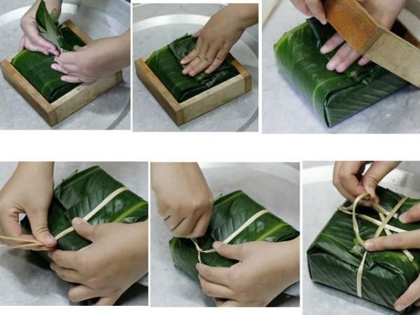 Cách làm bánh chưng - gấp các cạnh lá dong cho gọn và kép 2 đầu sợi lạt buộc bánh lại.